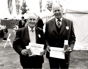 Bob, on the right, having just received his long service award along with his work mate at Watermill Farm, Jack Garrod