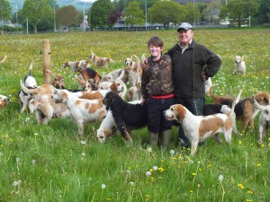 Mark Powell with his son Glyn and hounds
